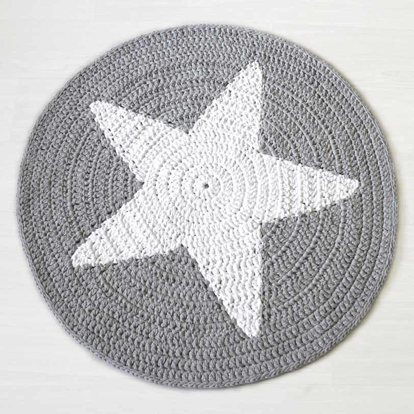 Valkoinen tähti harmaalla pohjalla matto