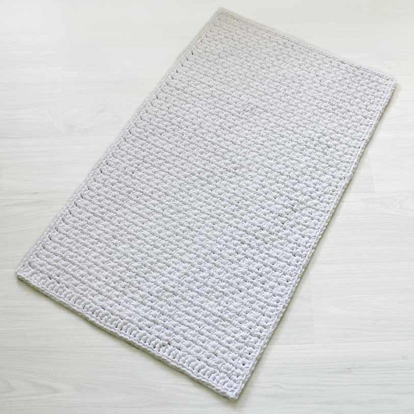 Skandityylinen suorakaide virkattu matto